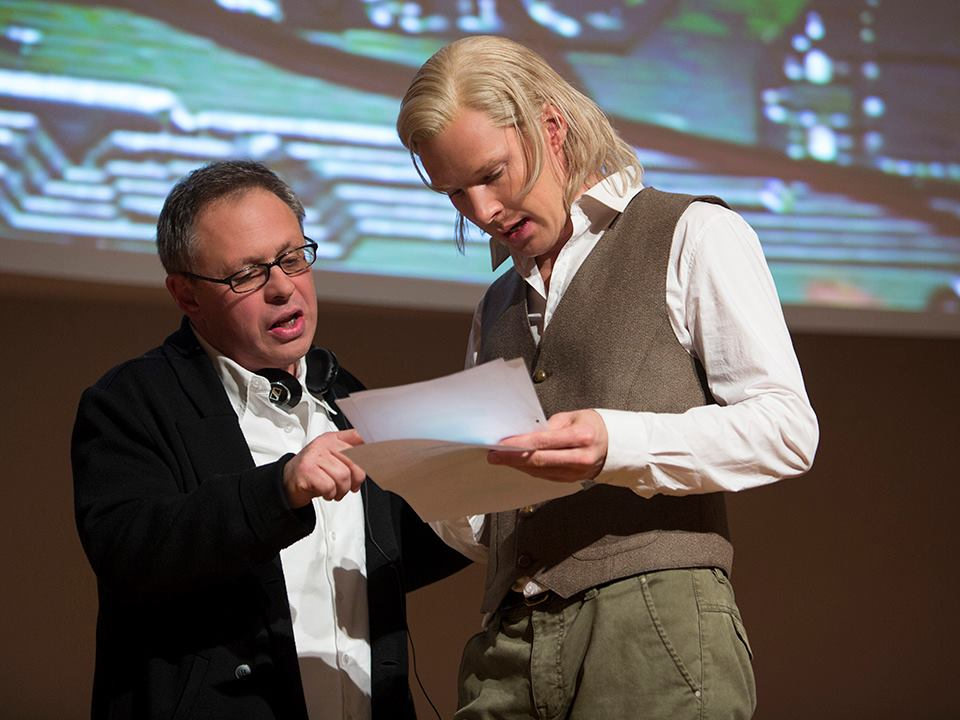 Filmmaker Bill Condon directing Benedict Cumberbatch as WikiLeaks founder Julian Assange